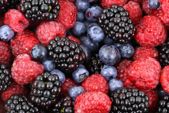 Close-up of blueberries, rasberries, and blackberries.